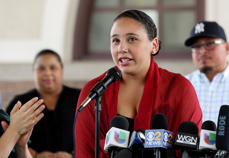 Mia Irizarry speaks at a news conference in Chicago, July 13, 2018, about an incident where a man confronted her about a T-shirt she wore emblazoned with the Puerto Rican flag at a Chicago forest preserve on June 14. Irizarry says a forest preserve p...