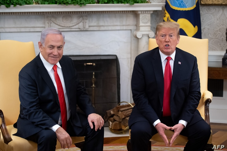 U.S. President Donald Trump and Israeli Prime Minister Benjamin Netanyahu hold a meeting in the Oval Office at the White House in Washington, March 25, 2019.