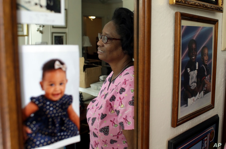 FILE - Gwen Strowbridge, 71, of Deerfield Beach, Florida, works six days a week caring for a 100-year-old woman. She has worked all her life and plans to work until she can't physically work anymore.