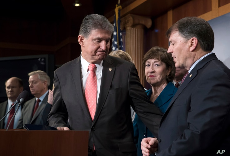 """Sen. Joe Manchin, D-W.Va. (C), Sen. Susan Collins, R-Maine, and Sen. Mike Rounds, R-S.D., join others in their """"common sense coalition"""" to discuss the bipartisan immigration deal they reached with other centrists this week that sought to offer citize..."""