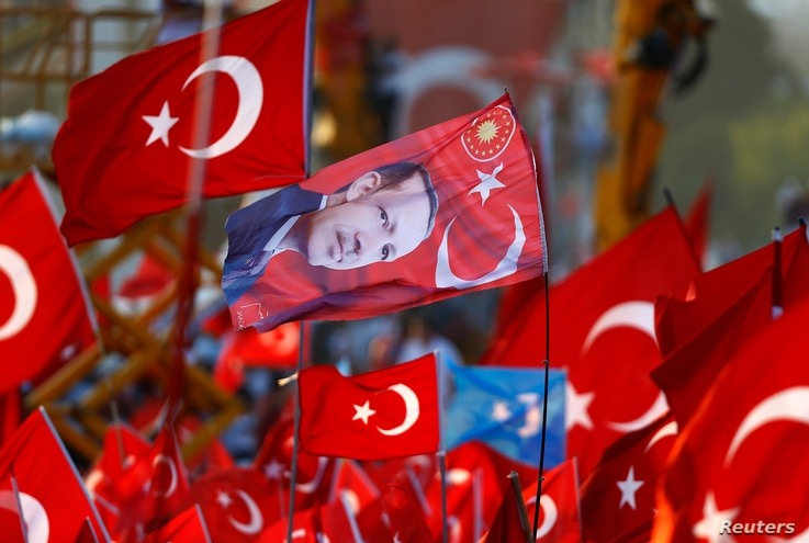 A flag with the picture of Turkey's President Tayyip Erdogan is featured during the Democracy and Martyrs Rally, organized by Erdogan and the ruling AK Party in Istanbul, Aug. 7, 2016.
