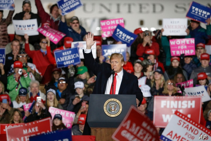 President Donald Trump speaks during a rally, Oct. 24, 2018, in Mosinee, Wis.