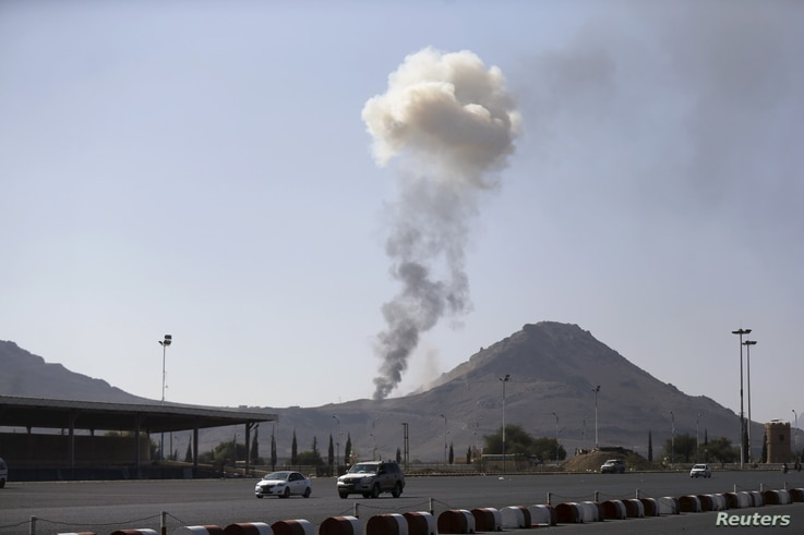 FILE - Smoke rises from an army weapons depot hit by a Saudi-led airstrike in al-Nahdain mountain in Yemen's capital, Sana'a, Oct. 25, 2015.