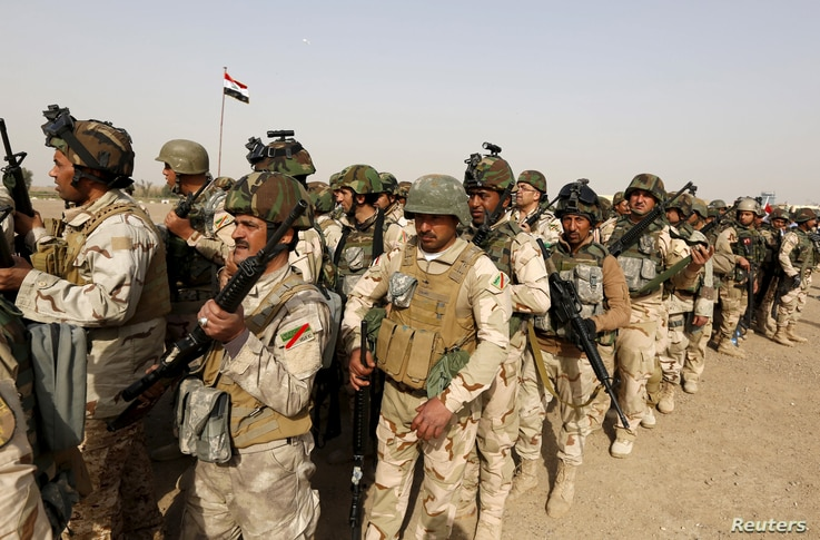 Iraqi forces travelling to Mosul
