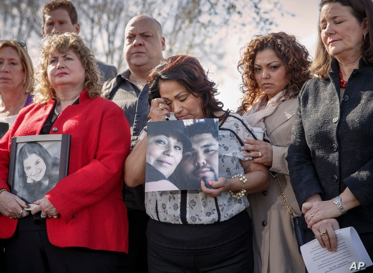 Rosie Cortinas (C) holding a photo of her son, Amador Cortinas, of Homedale, Idaho, who was killed on Oct. 18, 2013, while driving a friend home in a Chevy Cobalt, joins other families whose loved ones died behind the wheel of defective General Motor
