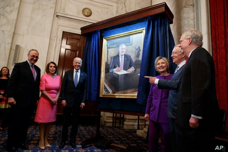 Senate Minority Leader Sen. Harry Reid, D-Nev., second from right, looks at a portrait of himself during a ceremony to honor his service in the Senate, on Capitol Hill, Dec. 8, 2016, in Washington.