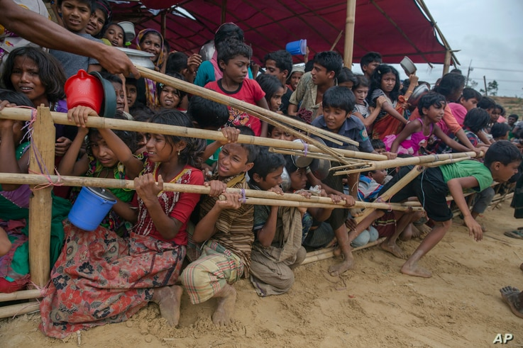 FILE - Rohingya Muslim children, who crossed over from Myanmar into Bangladesh, are squashed together as they wait to receive food handouts distributed to children and women by a Turkish aid agency at Thaingkhali refugee camp, Bangladesh, Oct. 21, 20...