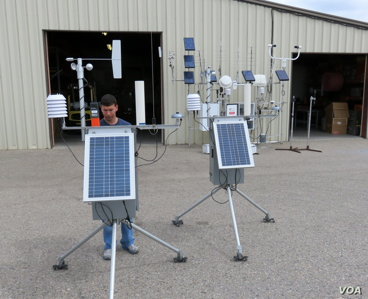 Technician Justin checks high-tech, portable weather stations before they are packed up for the next incident, July 2015. (VOA/T. Banse)