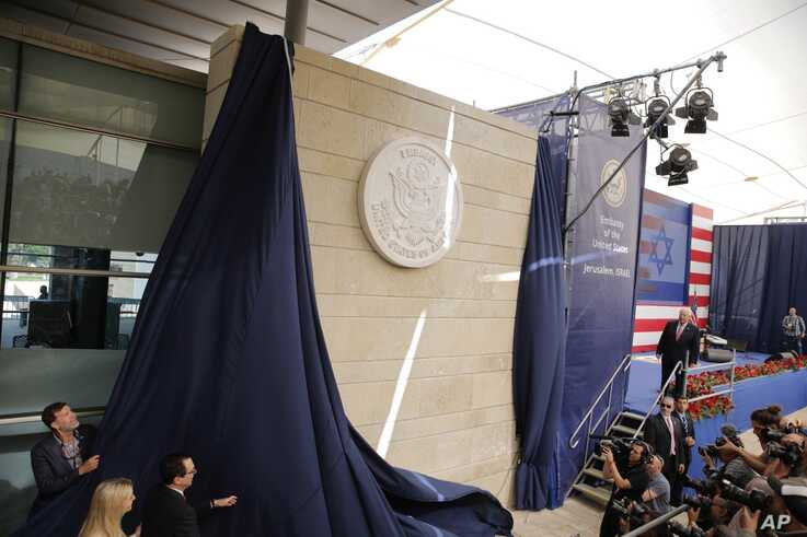 U.S. President Donald Trump's daughter Ivanka Trump (L) and U.S. Treasury Secretary Steve Mnuchin unveil an inauguration plaque during the opening ceremony of the new US embassy in Jerusalem, May 14, 2018.