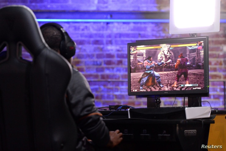 Competitors square off in a Tekken 7 tournament at Esports Arena in Los Angeles, Oct. 16, 2016.