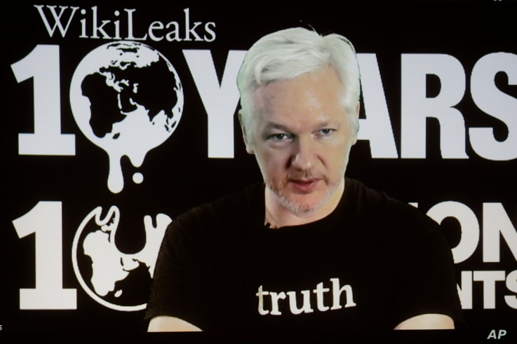 WikiLeaks founder Julian Assange participates via video link at a news conference marking the 10th anniversary of the secrecy-spilling group in Berlin, Germany, Tuesday, Oct. 4, 2016. Assange said that WikiLeaks plans to start a series of publication