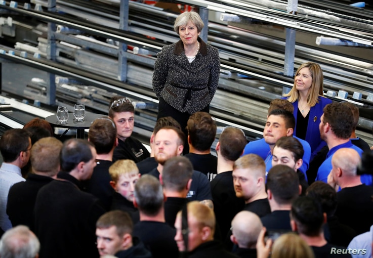 Britain's Prime Minister Theresa May visits a door manufacturer in Leeds, May 9, 2017.