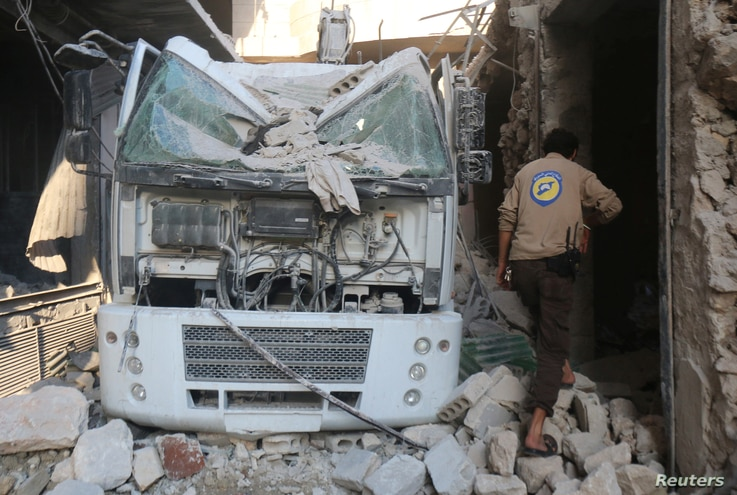 A civil defense member inspects the damage after their center was hit by an airstrike in a rebel-held area of Aleppo, Syria, Aug. 12, 2016.