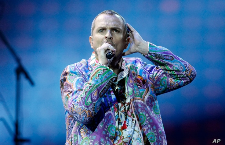 FILE - This Feb. 26, 2013 file photo shows singer Miguel Bose, of Spain, performing at the Vina del Mar International Song Festival in Vina del Mar, Chile.