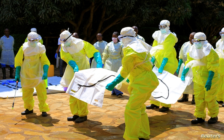 Congolese officials and the World Health Organization officials wear protective suits as they participate in a training against the Ebola virus near the town of Beni in North Kivu province of the Democratic Republic of Congo, Aug. 11, 2018.