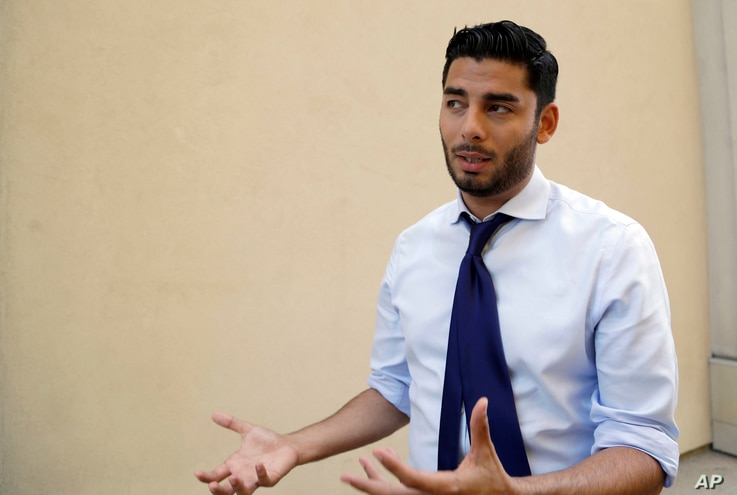 Democratic congressional candidate Ammar Campa-Najjar speaks during an interview, Aug. 22, 2018, in San Diego. Campa-Najjar, 29, has never held elective office but worked in the Obama administration Labor Department. He won second place in the state...