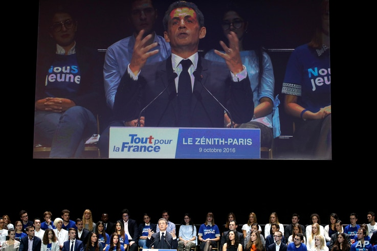 Former French President Nicolas Sarkozy is seen on a large screen during his speech as he runs for the 2017 presidential election in Paris, France, Oct. 9, 2016.