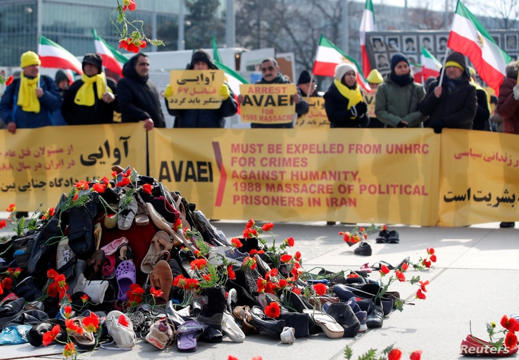 People demonstrate against the speech of Seyyed Alireza Avaei, Minister of Justice of Iran, at the Human Rights Council, in front of the United Nations in Geneva, Switzerland, Feb. 27, 2018.