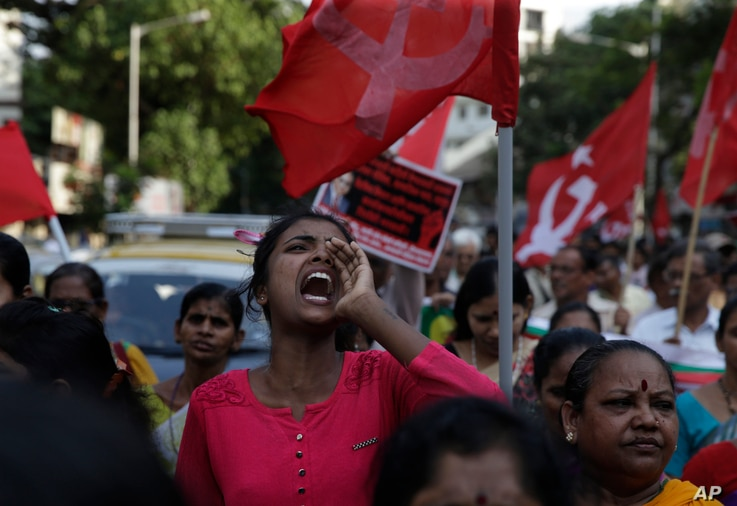 Members of Dalit organizations and leftist groups shout slogans during a protest in Mumbai, India, April 2, 2018.