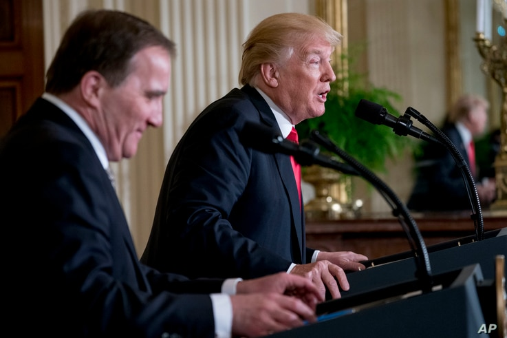 President Donald Trump accompanied by Swedish Prime Minister Stefan Lofven, left, speaks at a news conference in the East Room at the White House, March 6, 2018, in Washington.