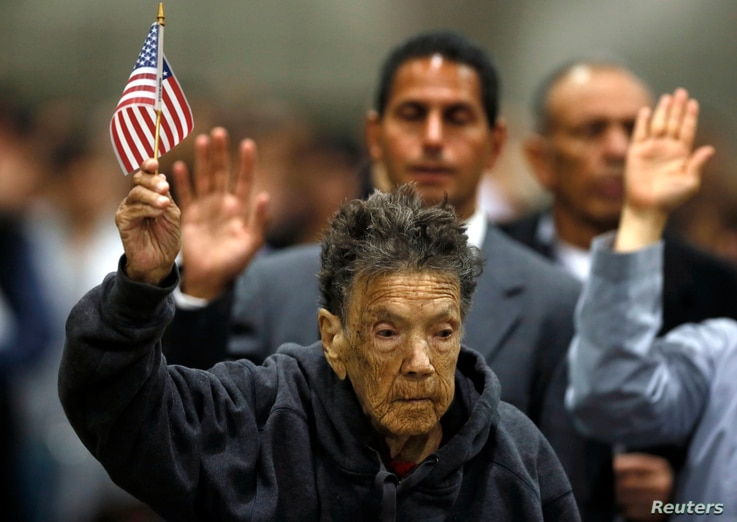 Ninety-seven-year-old Mercedes Rosa Ruiz Mejia from Nicaragua joins over 5,000 other immigrants taking the oath of citizenship during a naturalization ceremony in Los Angeles, California, April 16, 2013.