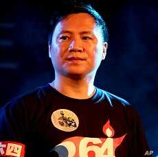 Wang Dan, one of the student leaders in the 1989 Tiananmen Square protests, takes part in a candlelight vigil for protesters crushed during the protests at the Liberty Square of the Chiang Kai-shek Memorial Hall, in Taipei, Taiwan, June 4, 2011.
