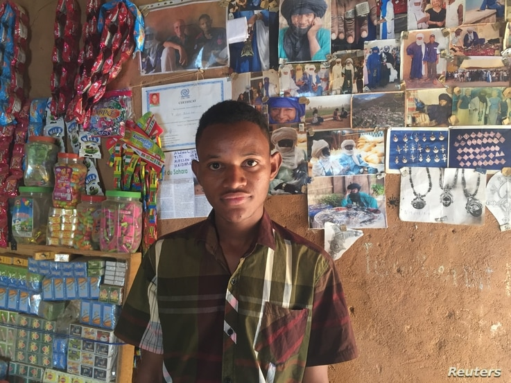 Abdoul Afori poses for a photo in his family's jewelry workshop, Agadez, Niger, Feb. 21, 2018.