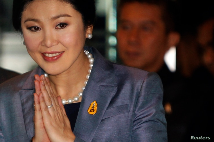 Thailand's Prime Minister Yingluck Shinawatra arrives at the Constitution court in Bangkok, May 6, 2014.