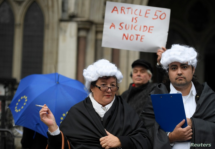 Demonstrators stand outside the High Court during a legal challenge to force the British government to seek parliamentary approval before starting the formal process of leaving the European Union, in London, Britain, Oct. 13, 2016.