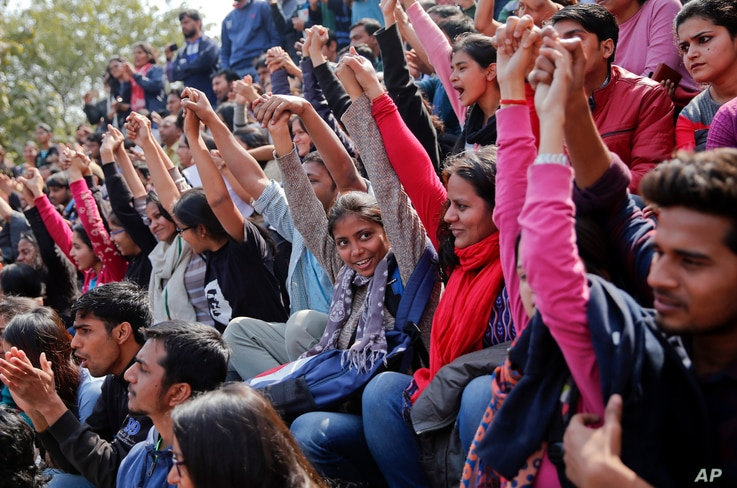 Indian students shout slogans during a protest at Jawaharlal Nehru University against the arrest of a student union leader in New Delhi, India, Feb. 16, 2016.