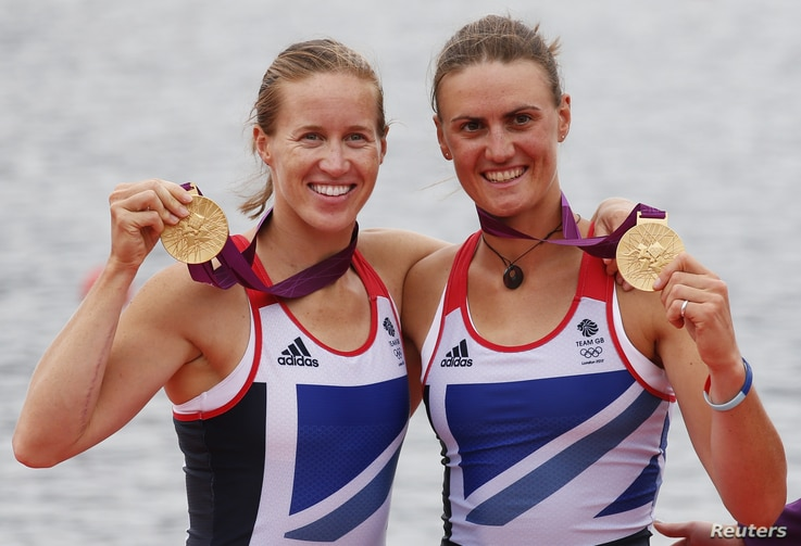 Britain's Helen Glover and Heather Stanning stand with their gold medals after the women's pair Final A at Eton Dorney during the London 2012 Olympic Games August 1, 2012.