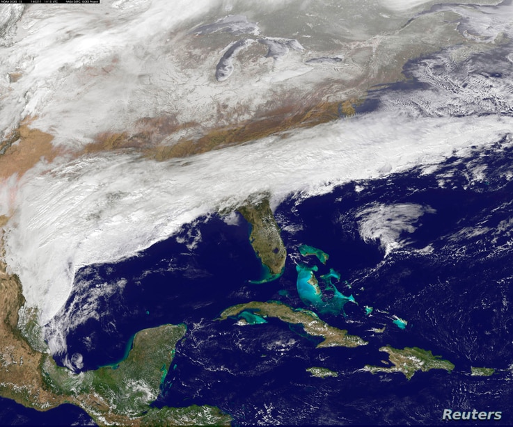 Clouds associated with a major winter storm that is bringing wintry precipitation and chilly temperatures to the U.S. South is seen in an image from NOAA's GOES-East satellite taken at 13:15 EST (18:15 GMT) February 11, 2014. A major winter storm thr