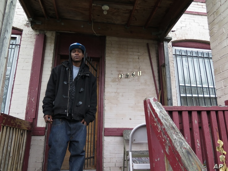 Craig House, 32, stands in front of his home in St. Louis, March 27, 2016.