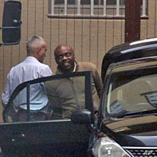 Nigerian ex-militant leader, Henry Okah (R) is led from the court in Johannesburg, 14 Oct 2010