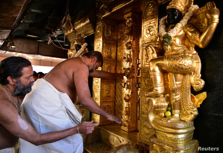 A priest closes the doors of sanctum sanctorum for performing religious rituals following the entry of two women in Sabarimala temple which traditionally bans the entry of women of menstrual age, in Pathanamthitta, India, Jan. 2, 2019.