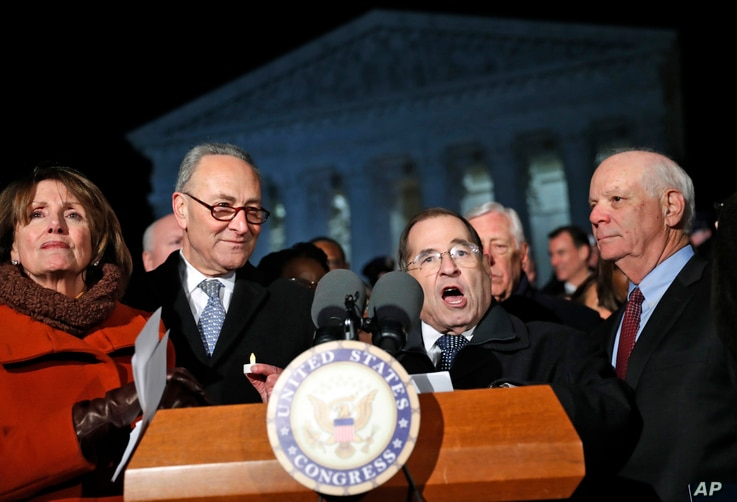 House Minority Leader Nancy Pelosi of Calif., left, and Senate Minority Leader Chuck Schumer of New York stand as Rep. Jerrold Nadler, D- N.Y., speaks in front of the Supreme Court in Washington about President Donald Trump's recent executive orders,...