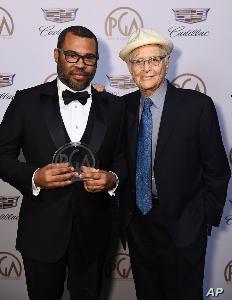Jordan Peele, recipient of the Stanley Kramer award, left, and Norman Lear attend the 29th Producers Guild Awards at Beverly Hilton, Jan. 20, 2018, in Beverly Hills, Calif.