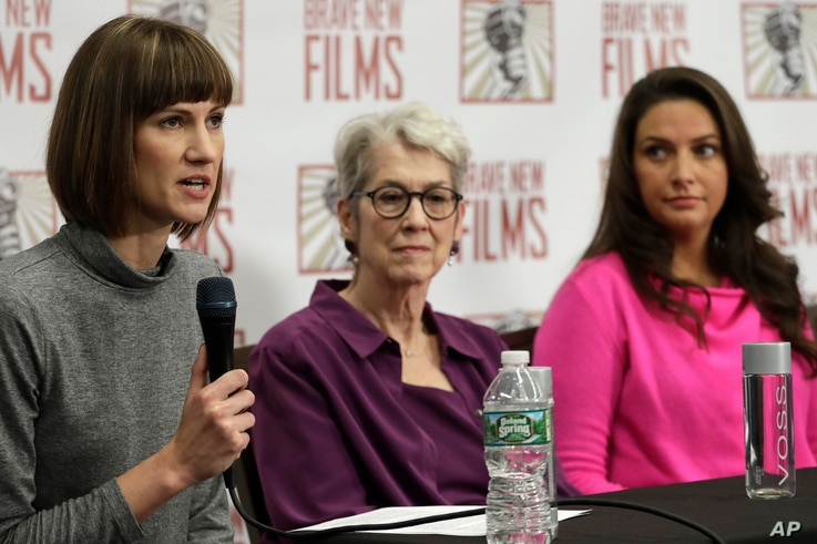 Rachel Crooks, left, Jessica Leeds, center, and Samantha Holvey attend a news conference, Monday, Dec. 11, 2017, in New York to discuss their accusations of sexual misconduct against Donald Trump. The women, who first shared their stories before the ...