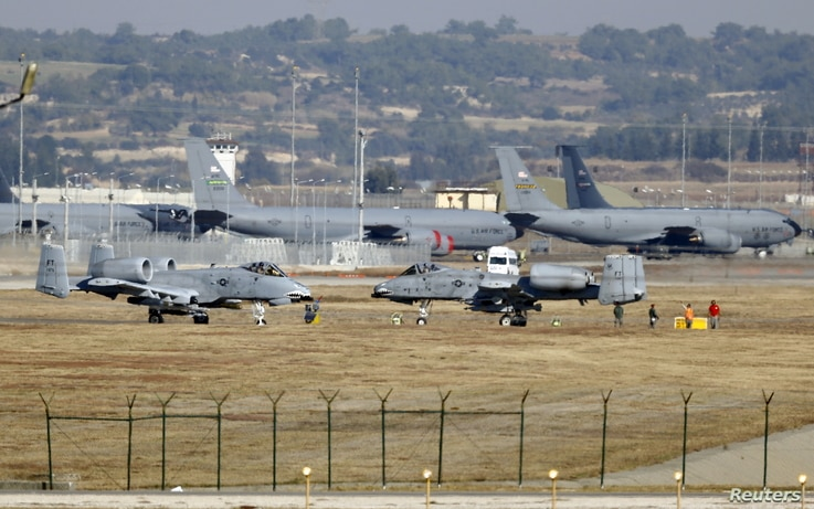 FILE - U.S. Air Force A-10 Thunderbolt II fighter jets (foreground) are pictured at Incirlik airbase in the southern city of Adana, Turkey.