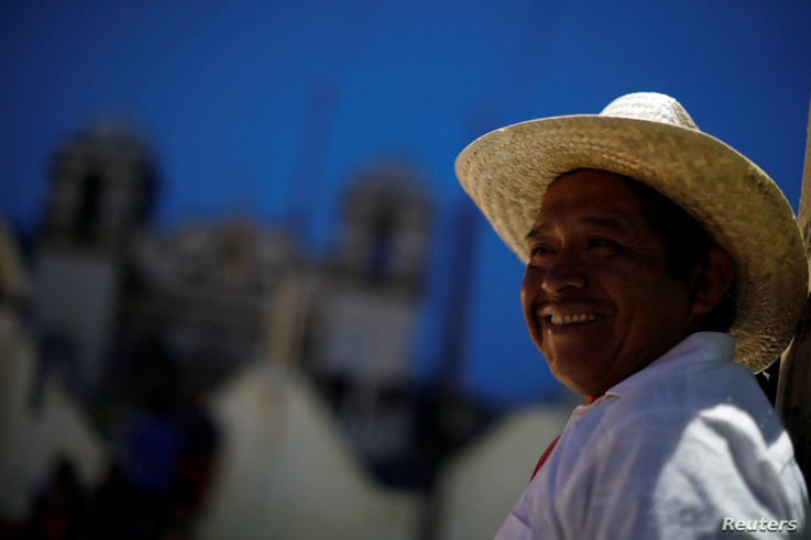 Cruz Gomes, a 44-year-old migrant from Guatemala, part of a caravan of thousands from Central America en route to the United States, smiles while rests in Santiago Niltepec, Mexico, Oct. 29, 2018.