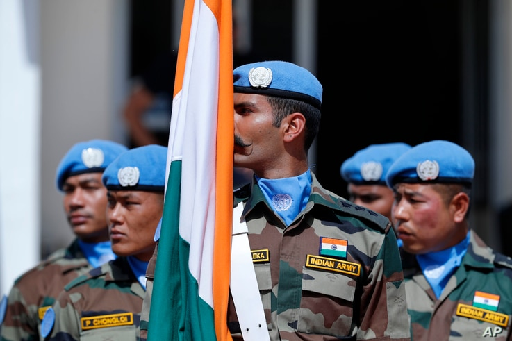 Peacekeepers from 41 different national contingents that make up the United Nations Interim Force in Lebanon (UNIFIL), stand at attention during a ceremony to mark the 40th anniversary of its peacekeeping presence in southern Lebanon, at the mission ...