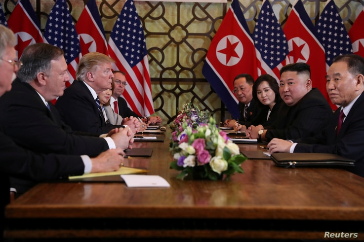 North Korea's leader Kim Jong Un and U.S. President Donald Trump attend the extended bilateral meeting in the Metropole hotel with U.S. Secretary of State Mike Pompeo, White House national security adviser John Bolton, acting White House Chief of Sta...