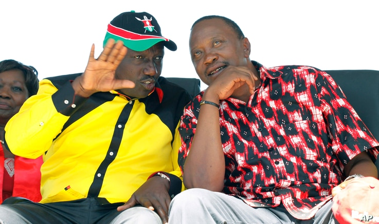 The National Alliance Party (TNA) presidential candidate Deputy Prime Minister Uhuru Kenyatta right, and his running mate William Ruto, talk during a rally at Uhuru Park, in Nairobi, January 12, 2013.