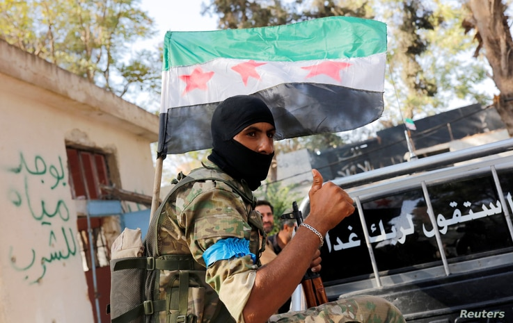 FILE - A member of Turkish-backed Free Syrian Army (FSA) is pictured in the border town of Jarablus, Syria, Aug. 31, 2016.