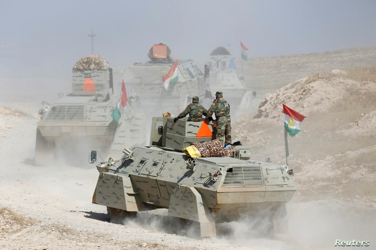 Peshmerga forces advance in the east of Mosul to attack Islamic State militants in Mosul, Iraq, Oct. 18, 2016.