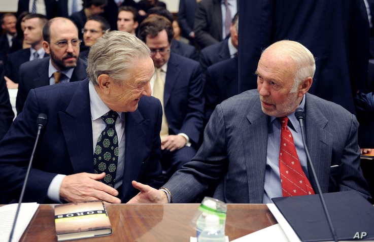 FILE - Soros Fund Management chairman George Soros, left, shakes hands with Renaissance Technologies President James Simons on Capitol Hill in Washington, Thursday, Nov. 13, 2008, prior to testifying before the House Oversight and Government Reform C...