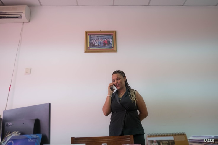 Suzy Carla Barbosa, parliament member and second vice president for the PAIGC part in Guinea Bissau, talks on the phone in her office, Dec. 14, 2017. (R. Shyrock)