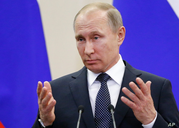 Russian President Vladimir Putin gestures as he speaks to the media after his talks with German Chancellor Angela Merkel at Putin's residence in the Russian Black Sea resort of Sochi, Russia, May 2, 2017.