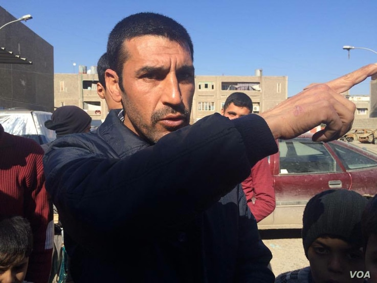 Former local police officer Fowas tells his story near his home in Mosul, Iraq on Feb. 8, 2017. In areas still controlled by IS, he and scores of other residents say, former local police are rounded up as Iraqi forces approach.  Many are killed. (H.M...