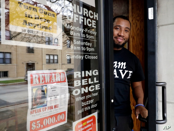 Lamar Johnson, a counselor for the church program B.R.A.V.E. Youth Leaders, stands at St. Sabina Church in Chicago, Nov. 9, 2018.